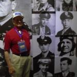 J.V. Vinyard posing next to his war time photo.