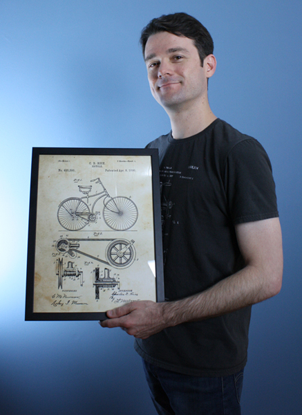 Me with an 1800's bicycle patent art print from Patent Earth
